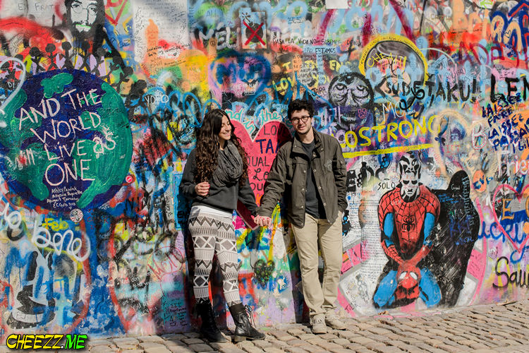 Beautiful couple at Lennon Wall in Prague